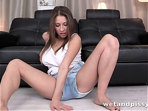 Desperate chick pissing her jeans cut-offs