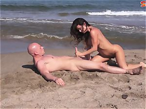 gigantic boobed cougar Gets pounded On A Beach