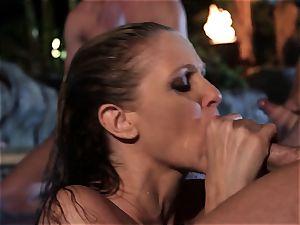 Julia Ann gargles a group of spunk-pumps in a pool