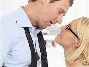Vanessa box leans over the desk and takes her bosses shaft