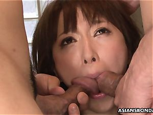 spurting japanese is roped up and used in a threesome